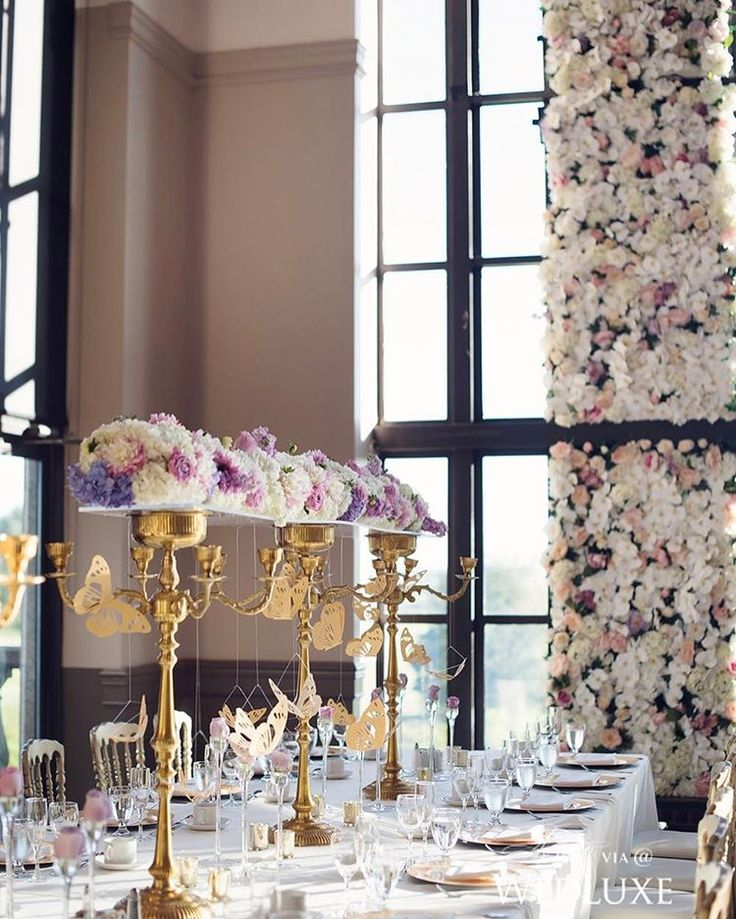 Gold origami butterflies were suspended from #centrepieces at this #Vancouver #wedding, giving the event a truly ethereal feel. See more from this wedding on WedLuxe.com, plus get the full story in our new W/S 2017 issue on newsstands NOW! (: @hongphotography, planning, @paisleyeventsinc, floral: @flowerzinc, decor and dance floor: @koncept.events)