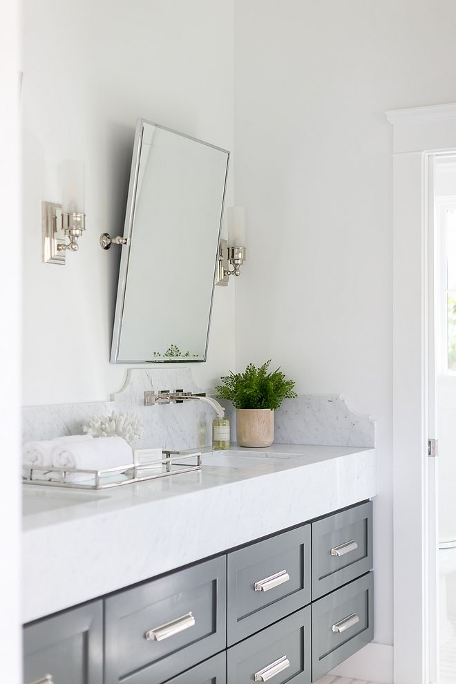 Chunky Countertop With Tall Curved Marble Backsplash Countertop Is