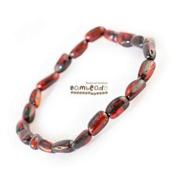 This may be an alternative to assist with general aches and pains, eczema and arthritis. This 18cm Bambeado amber adult Dark Cherry bean bracelet is made from large bean shaped amber pieces that have been polished so that there are no sharp edges. The amber beads bracelets are mounted on a strong elastic thread and are gorgeous on. While Bambeado amber comes in several colours, the colour is just a matter of personal choice.