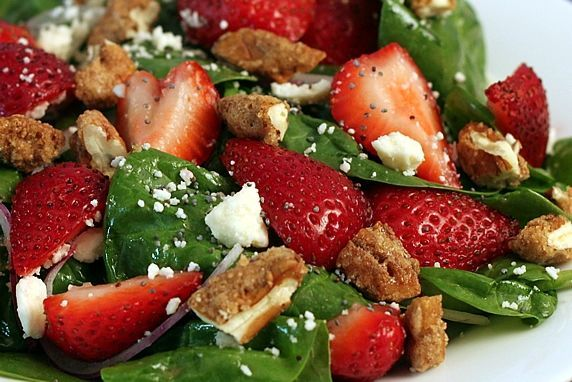 Spinach Strawberry Salad w/ Candied Pecans, Feta, & Raspberry Poppyseed dressing.
