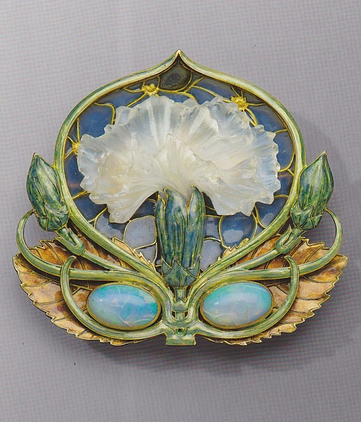'Carnation' brooch, by René Lalique, circa 1900-1902. Gold, enamel, opal, and moulded glass.                                                                                                                                                      More