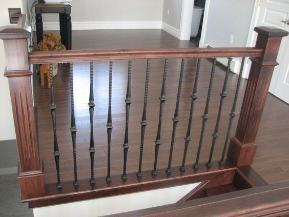 Top of stairs--Oversized Fluted Box Newels & Hammered Spoon Metal Balusters - Picture #10