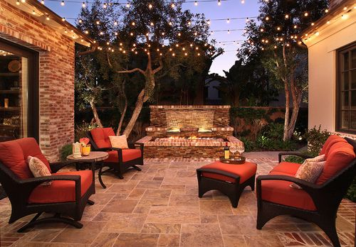 Love this warm outdoor space with string lights.
