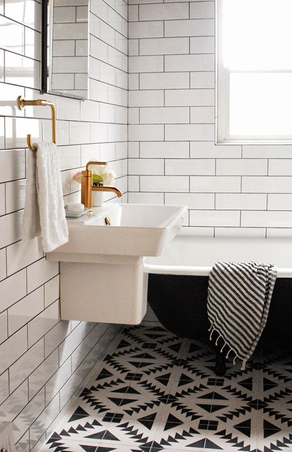 Love the black and white bathtub and the subway tile. The copper appliances give the bathroom some warmth. Black and white bathrooms | Bathroom renovation by Capree Kimball via Poppytalk