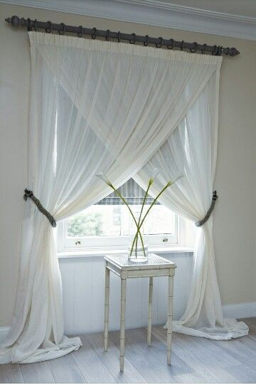 Such a pretty way to hang curtains especially for a window without a view