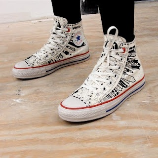 """Vena Cava reinterprets the all-American Converse sneaker by """"graffiti""""-ing them with an Art Deco/Native American-inspired Havasu print. Part of the proceeds from the sales went to the Global Fund to Fight AIDS."""