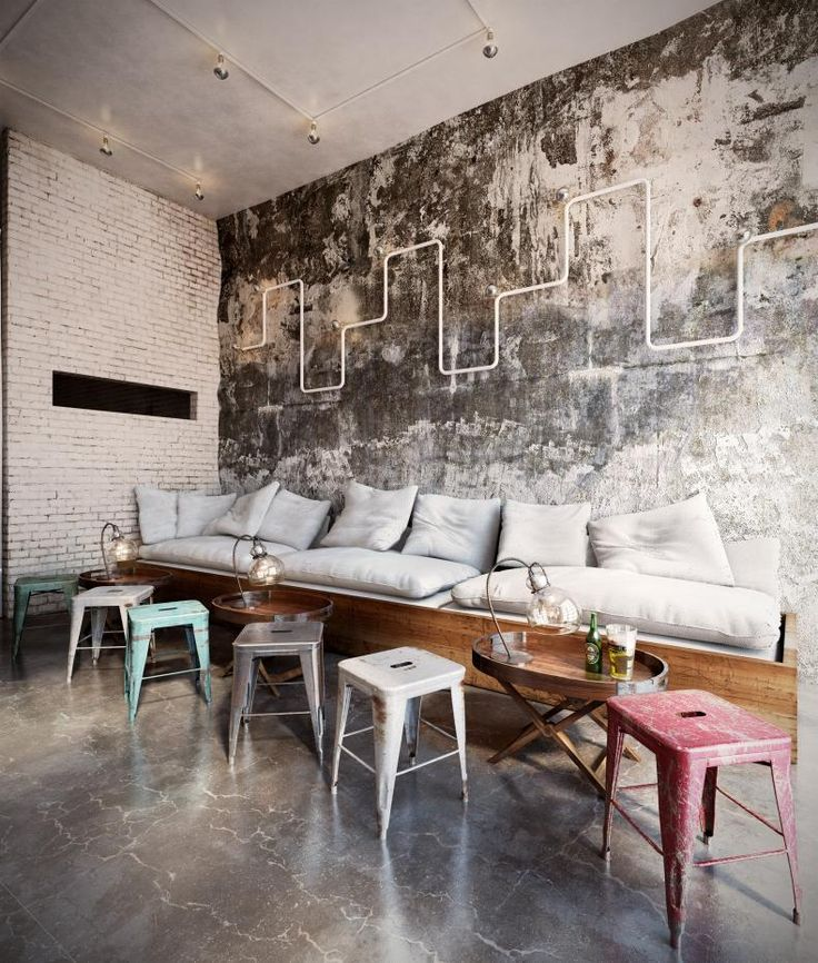 the industrial feel in this space is softened by the use of timber and plush cushions to soften it up further add some coloured cushions to complement the - Restaurant Decor