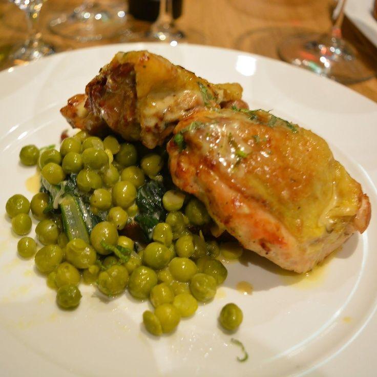 Theo Randall Dinner - wood roasted Guinea Fowl stuffed with prosciutto thyme mascarpone and lemon zest on pagnotta bruschetta and new season italian peas. .