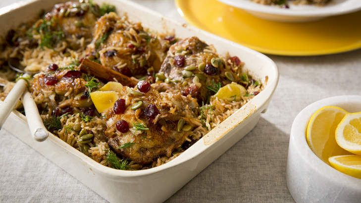 Braised chicken with spiced rice, cranberries and dill