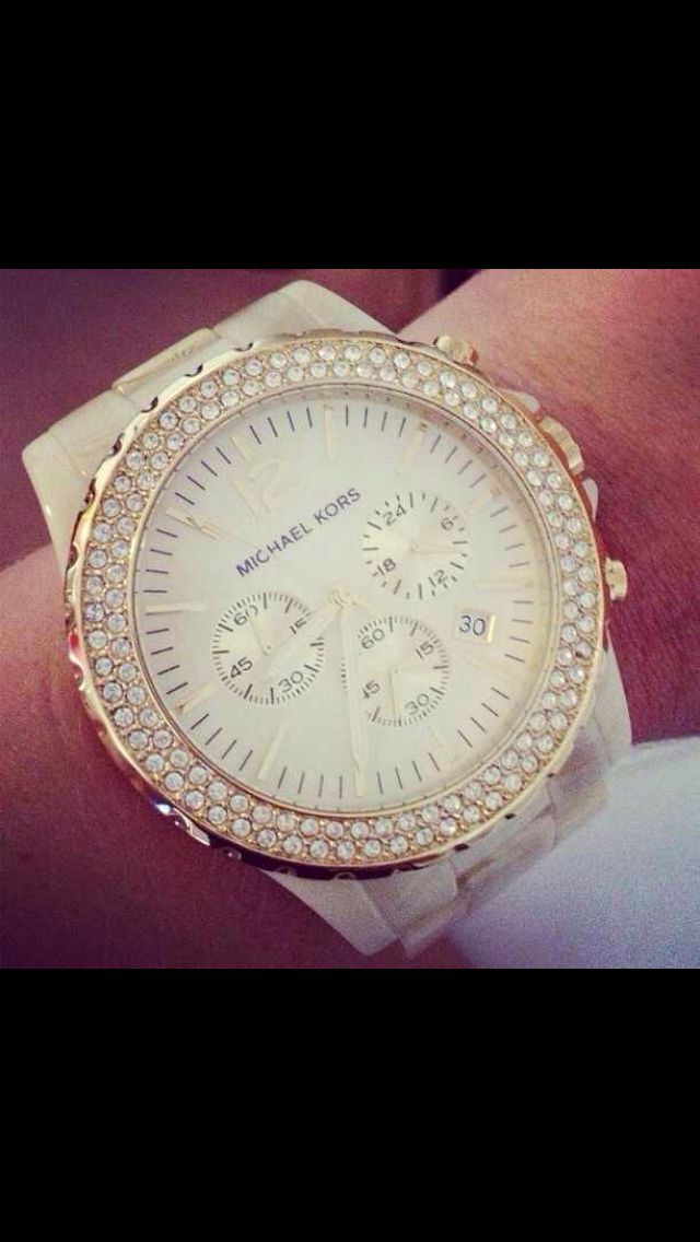 Micheal Kors watch. I HAVE TO HAVE THIS WATCH!! it will cover my tattoo :)