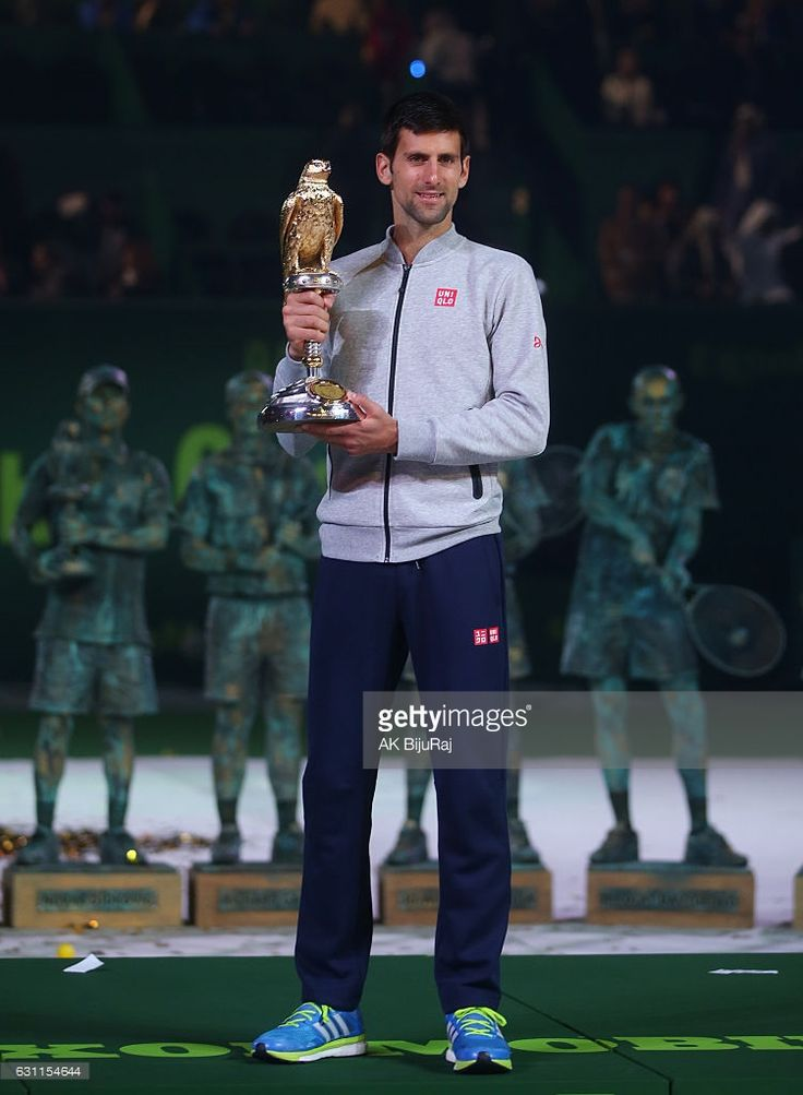 Novak Djokovic of Serbia celebrates with the trophy after winning the men's singles final of the ATP Qatar Open tennis competition against Andy Murray of Great Britain held at the Khalifa International Tennis Complex on January 7, 2017 in Doha, Qatar.