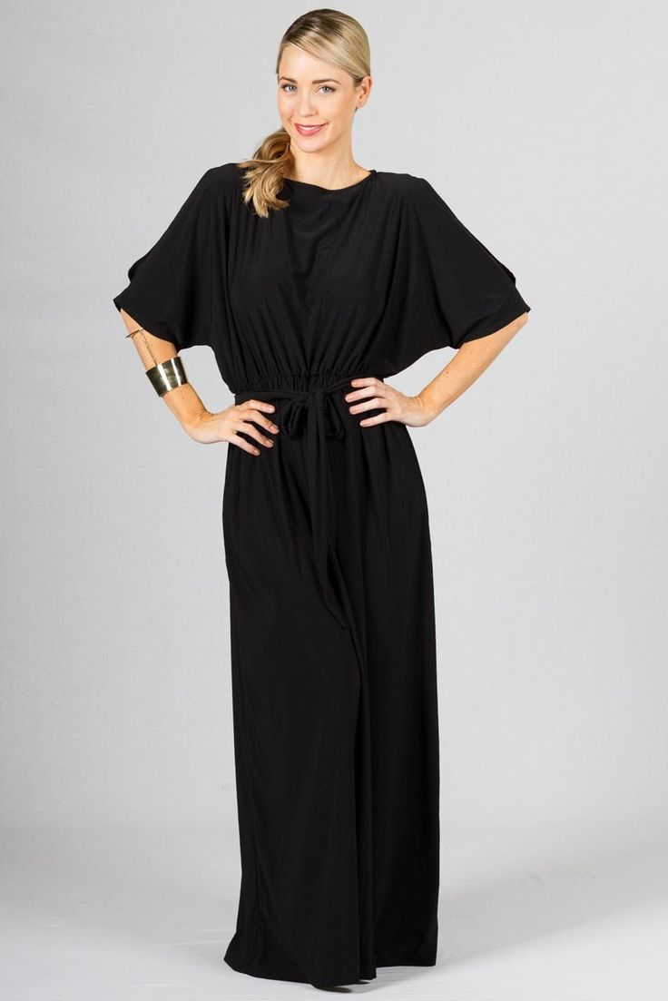 """Alice Batwing Maxi Dress - Black - Paper Scissors Frock  Batwing style sleeve maxi dress with split feature on the sleeve. Elasticised at the waist and frock comes with a matching fabric belt. Made from ITY Matt Polyester.  Pictured Model 5'8"""""""