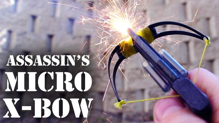 Mini crossbow from hairclips, embroidery floss, toothpicks, a sharpie, matchsticks, and hot glue