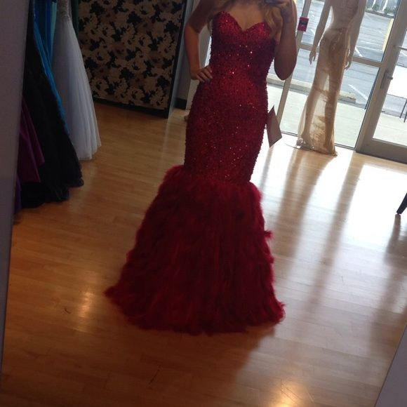 Red Feather Jovani Gown Red Feather Jovani Gown. Worn once. No alterations done, perfect condition. Winning gown for a Miss Teen USA preliminary. Current style. Perfect for pageants, prom, or other formal events. Jovani Dresses