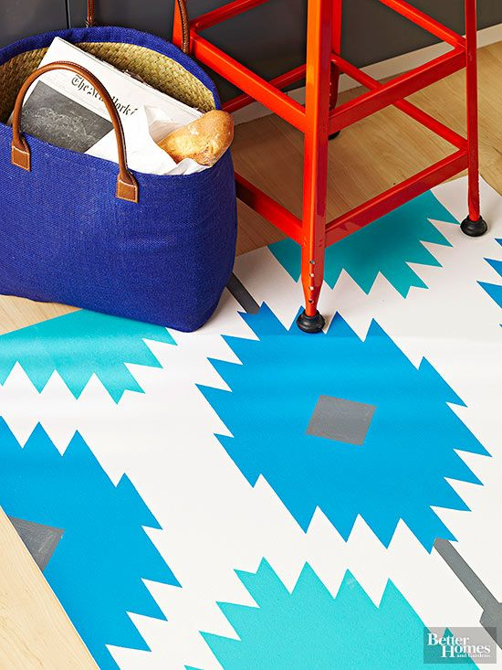 Turn a piece of plain vinyl flooring into a stylish rug for your kitchen with a simple stenciled makeover.