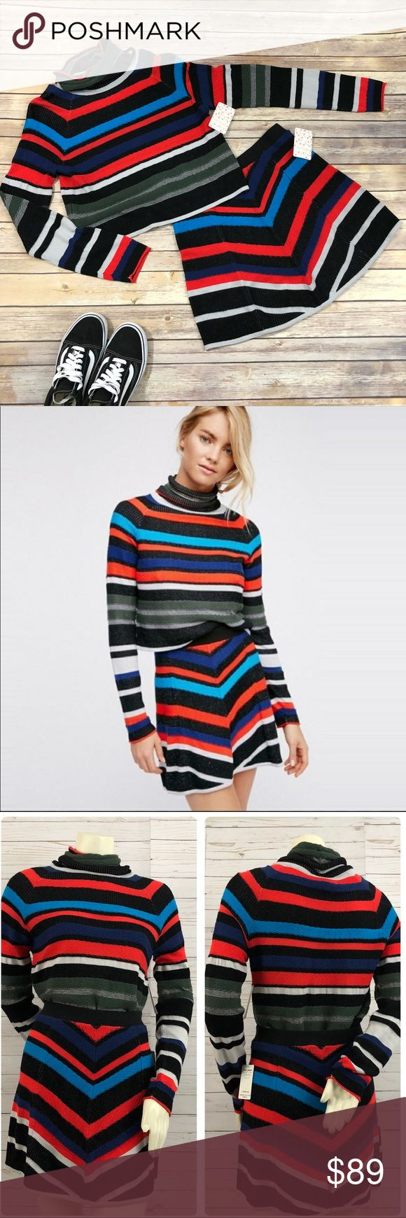 NWT Free People what a flirt sweater & skirt set NWT Free People what a flirt mini skirt and sweater set. Striped knit with black, red, blue, green and light gray. Sweater has a turtleneck cowl neck and long sleeves. Skirt is a mini with a chevron pattern and elastic waistband. You can wear them together or separate. You could wear the sweater with a pair of jeans. The skirt could be worn with a plain black top. Giving you lots of style options.   Hand wash.  60 rayon, 31 cotton, 9 lyocell…