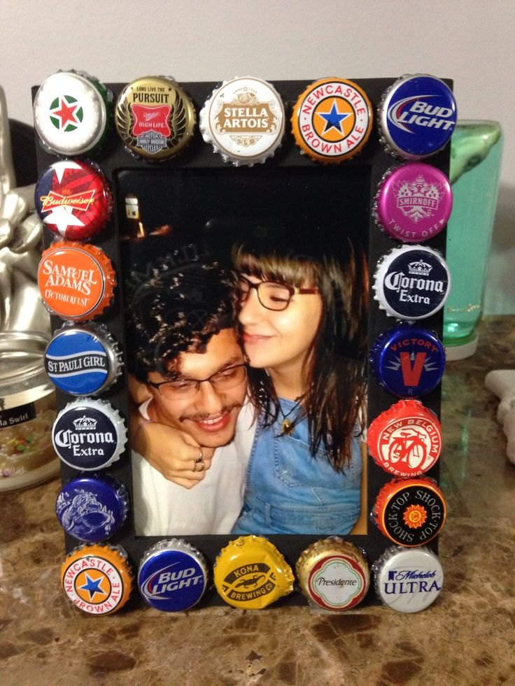 21st birthday gift for my boyfriend (: painted a $1.99 wooden frame from Michael's in black & just hot glued beer caps