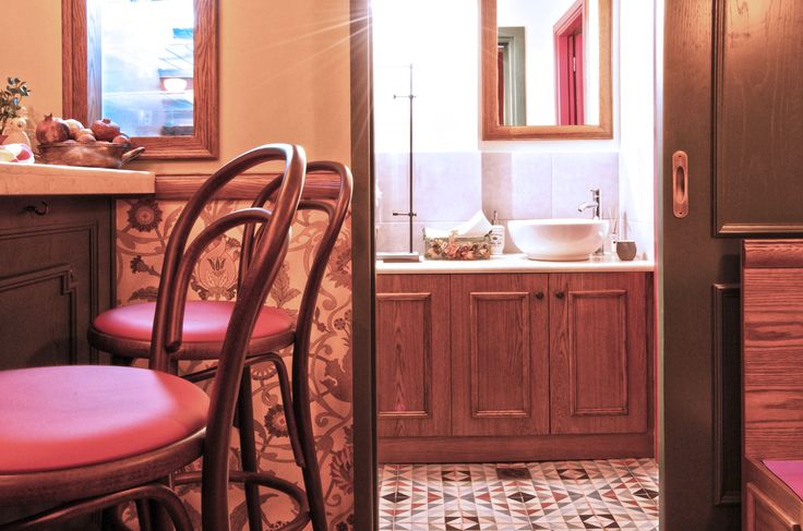 Traditional Tiles, floral wallpaper and  wooden furniture | Retro bar Interior by AkPraxis. To see the whole project visit http://www.akpraxis.gr/portfolio/old-pharmacy #old_pharmacy #bar #interior  #design