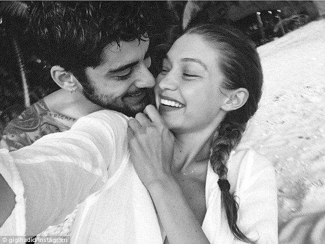 Can't hide their smiles! On Wednesday Gigi Hadid shared a heartwarming black and white photo of her and Zayn Malik cuddling together on Instagram