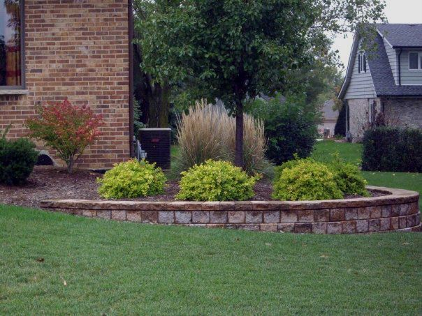 Landscaping Bi Level Home Retaining Wall On Corner Of Brick House Landscape