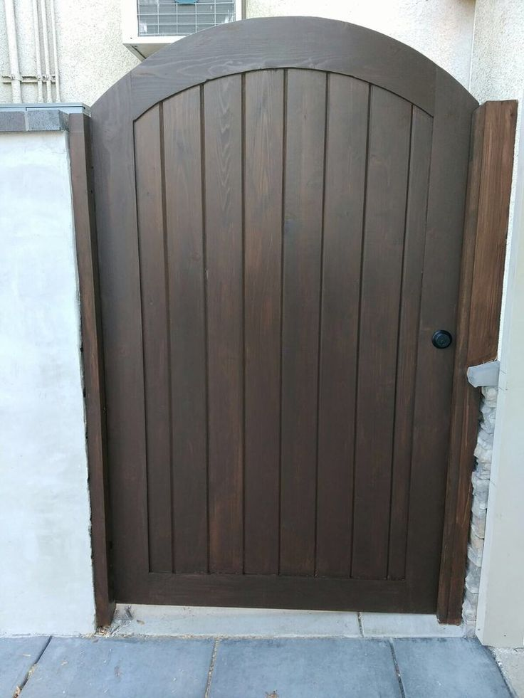 Photo of OC Local Garage Door & Gate - Costa Mesa, CA, United States. Supply and install new custom wood gate in Long Beach oc local garage Door gate