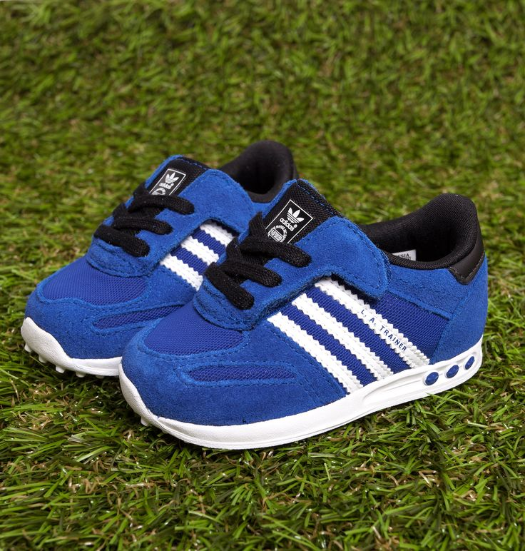 Get your little one ready for a summer of sport in the Adidas LA blue and white trainers