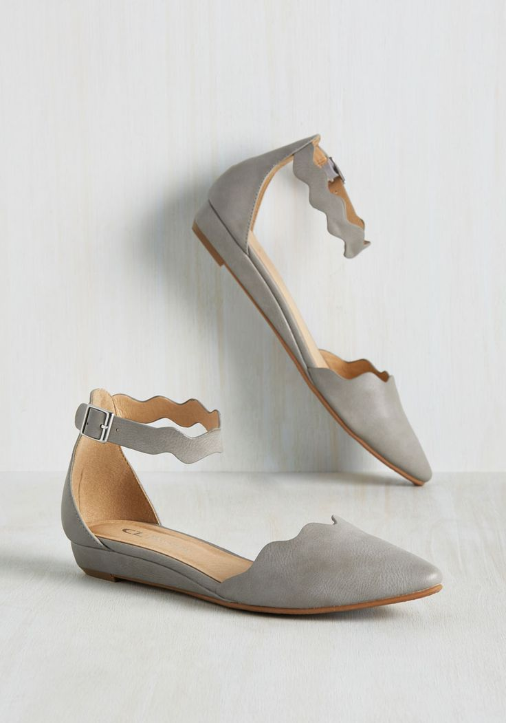 How many looks can you create with these grey flats? A week's worth or even a summer-long stretch? We predict it's more like a lifetime - because these versatile mini wedges - which flaunt faux-leather uppers, wavy straps, and silver buckles - are stylish in every season!