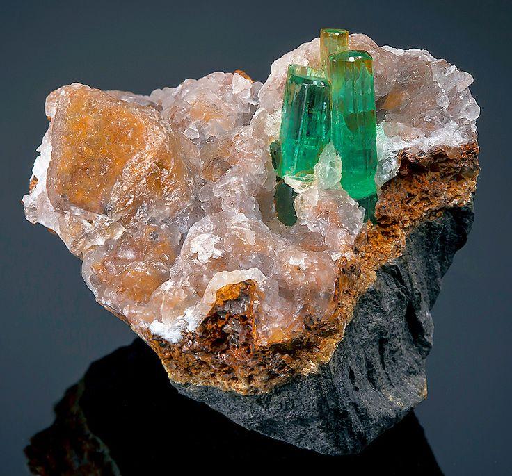 Gorgeous specimen featuring four Beryl var Emerald crystals on Calcite. Chivor Mine, Guavió-Guatéque Mining District, Boyacá Department, Colombia-