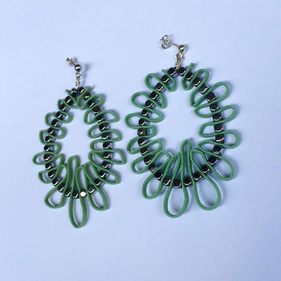Big silver hoops with hematite and man made light green