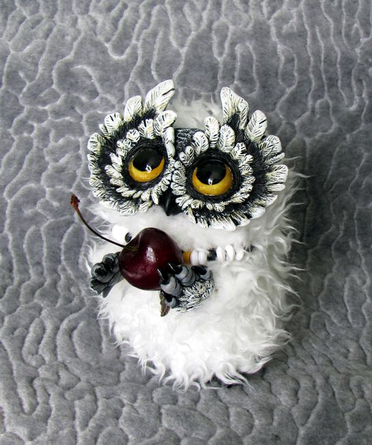 It's a commission for 5 inches, made of clay and faux fur. Hand painted.