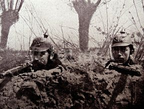 WWI; Belgian soldiers with captured German helmets in the trenches.