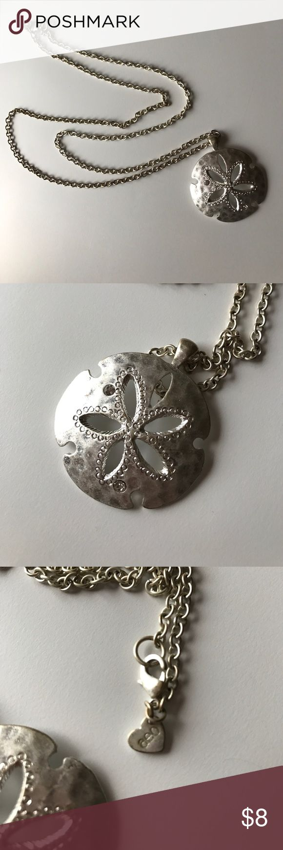 Long silver sand dollar pendent necklace American Eagle long silver pendent sand dollar necklace. Pendent features two rhinestones. American Eagle Outfitters Accessories