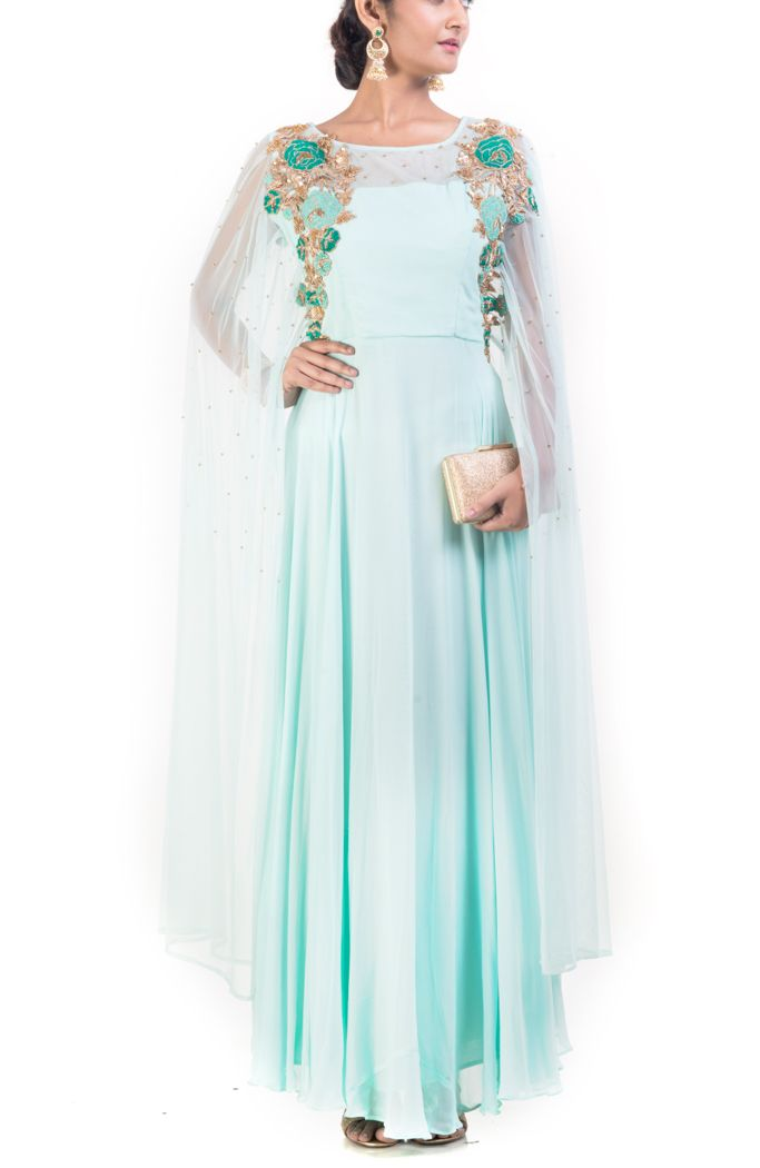 Featuring a floral embroidered aquamarine dress with cape sleeves. Yoke has intricate zardosi embroidery. The embroidery is done using sequins, french knot, dori and golden pearl.
