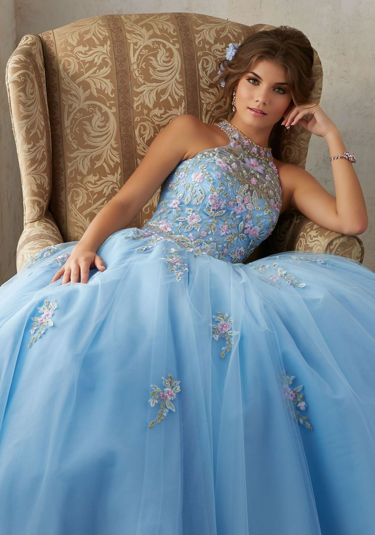Morilee Quinceanera Dresses  STYLE NUMBER: 89134 Embroidery and Beading on a Tulle Ballgown  Gorgeous Floral Embroidey Takes Center Stage on This Tulle Quinceañera Dress with Corset Back. Delicate Beading Accents the High Halter Neckline. Matching Bolero Stole Included. Colors Available: Bahama Blue, Bubble, Light Purple.
