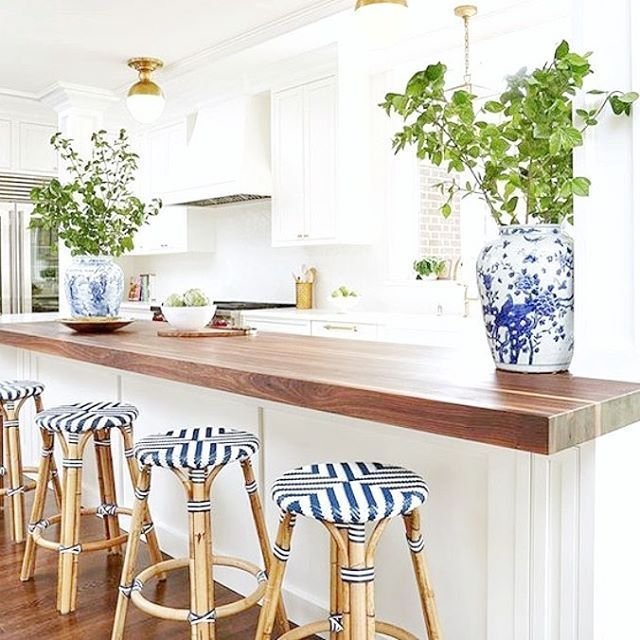 White Kitchen, Brass Lighting, Wood Accents, Blue And White Ginger Jars AND  Stools