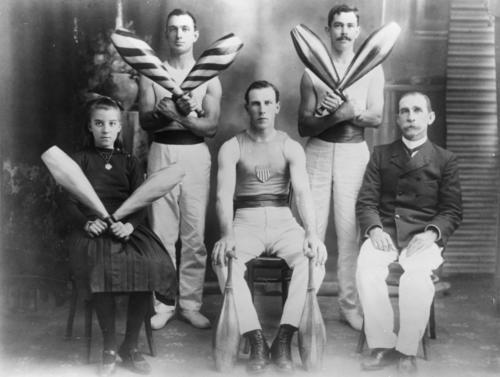 Gymnastics group form Rockhampton, Australia posing with Indian clubs, circa. 1890