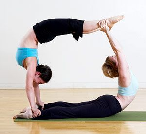 Loop de Loop Acroyoga pose (definitely not for beginners!) I might have been able to do this in days past. Now I just do it in my dreams!