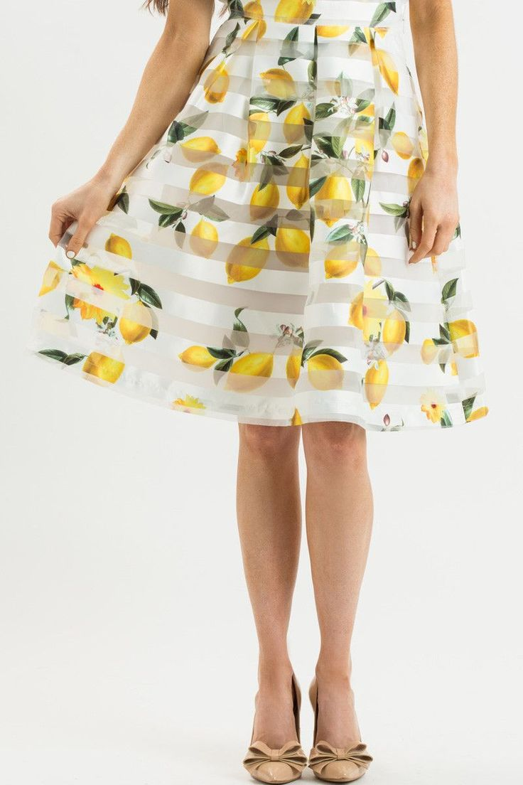 Whimsical, yet stunning. Our new lemon print skirt is perfect for wine tasting or Sunday brunch this Summer! The bright yellow print and mesh stripes give this midi skirt a chic yet girly feel. Pair i