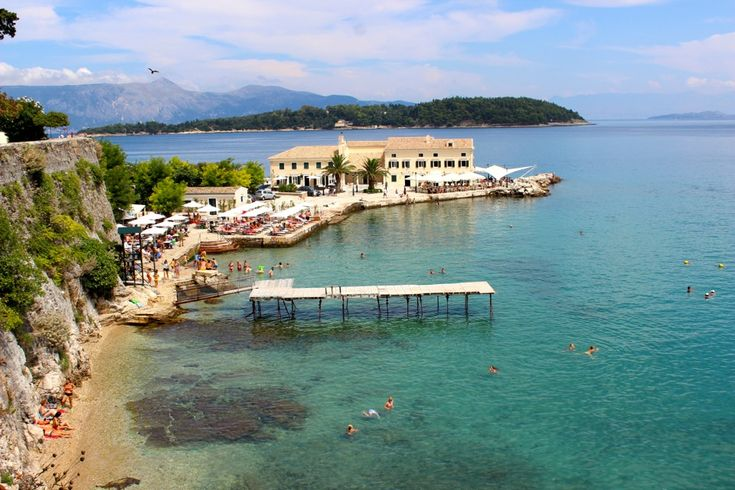 Picture perfect swimming beach in Old Corfu, Greece. #ttot