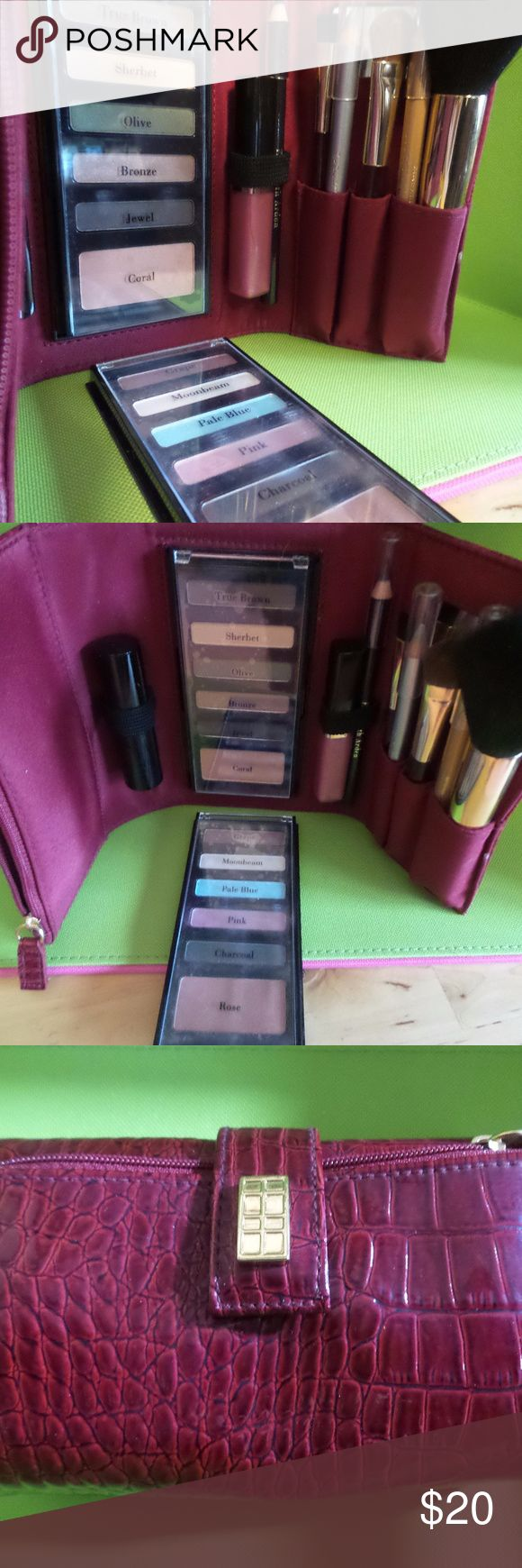 NEW ELIZABETH ARDEN 11 Piece Beauty Collection Comes all in a beautiful faux leather case. Includes 10 shadows in grape, moonbeam, pale blue, pink, charcoal, true brown, sherbet, olive, bronze, jewel. 2 blushes in rose and coral. 1 lipstick in Solar 1 high gloss lip shine in pink sparkle 3 eye pencils in smokey black, gold, silver. 3 make-up brushes. Elizabeth Arden Makeup