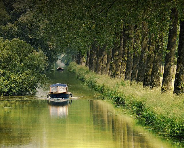 "A picturesque canal between the Loosdrechtscheplassen and the river The Vecht. One of the most beautiful rivers in Holland. This river is a Rhine branch in the Dutch province of Utrecht. The area along the river is called the ""Vechtstreek""."