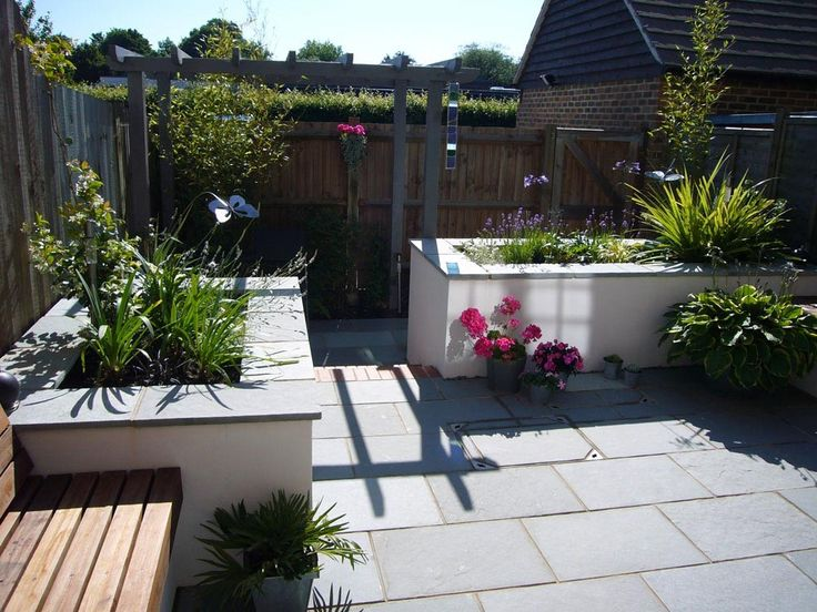 Beautiful garden looks more attractive and modern by using kota blue tiles.