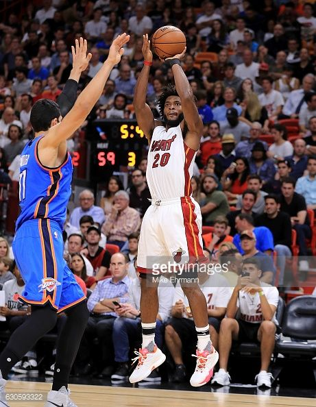 News Photo : Justise Winslow of the Miami Heat shoots over...