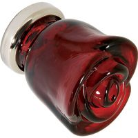A rose by any other name... Royal Red Glass Rose Doorknob.  Perhaps this would be perfect on an exterior door that leads to your garden?