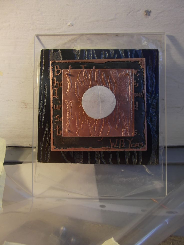Etched blue steel,  electro etched copper with an embossed copper plate, with circle of embossed silver