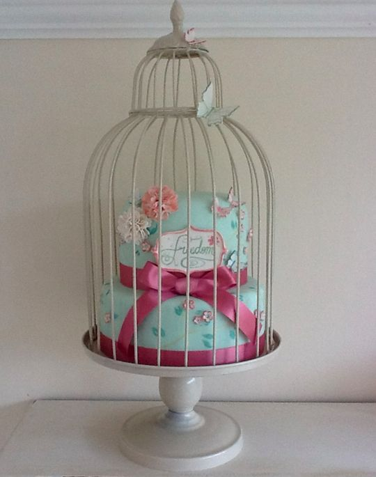 Freedom #divorce #party #cake. This is one of my favorite divorce party cakes because it's elegant, classy and most likely recycles the birdcage card holder from the wedding. It's too pretty to eat, but I would totally dig in. #trashthedress #divorceparty #birdcage #vintage #classy #elegant #teal #pink