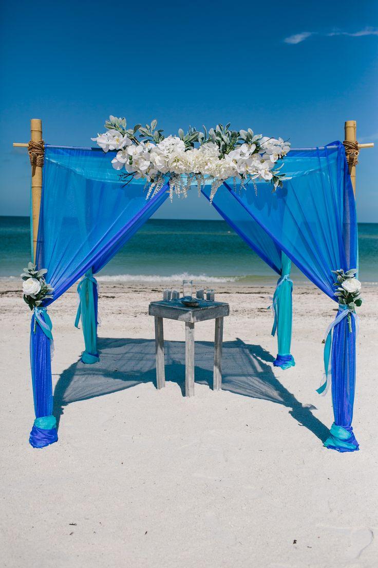Royal and teal beach wedding arbor.