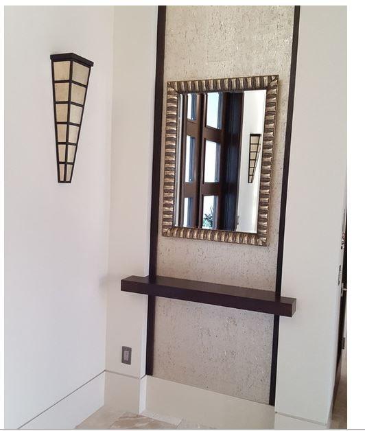 corner coat closet, wallpaper accent