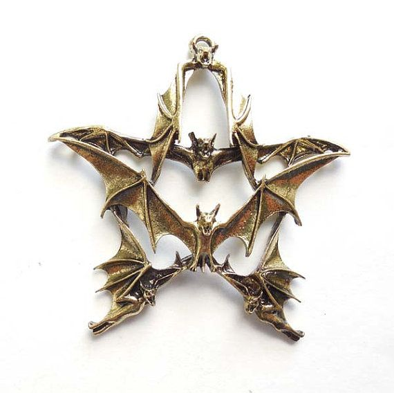 1 Antique Bronze Bat Star Charm--Have never seen this before, and it is so weird that I *almost* like it.