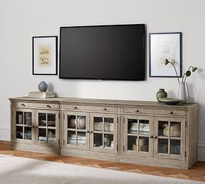 100 in long, 30 in tall,  $1530 w 15% off, plus 10% shipping,  Livingston Large TV Stand | Pottery Barn